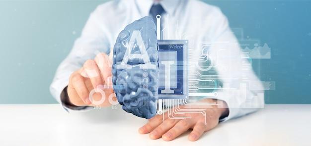 Homem negócio, segurando, inteligência artificial, ícone, com, metade, cérebro, e, meio, circuito, 3d, fazendo Foto Premium