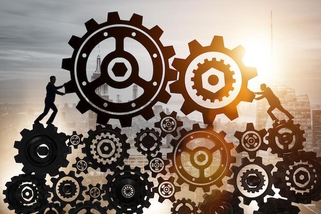 Homem negócios, em, trabalho equipe, conceito, com, cogwheels Foto Premium