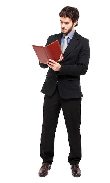 Homem negócios, escrita, ligado, seu, agenda Foto Premium