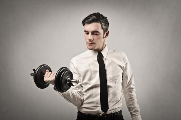 Homem negócios, levantamento, peso Foto Premium