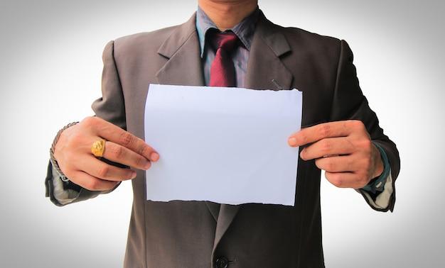 Homem negócios, mostrando, em branco, papel Foto Premium