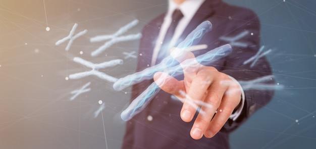 Homem negócios, segurando, um, grupo, de, cromossoma, com, dna, dentro, isolado, 3d, fazendo Foto Premium