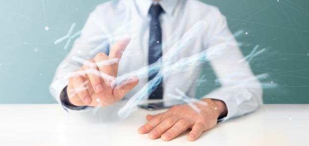 Homem negócios, segurando, um, grupo, de, cromossoma, com, dna, dentro, isolado Foto Premium