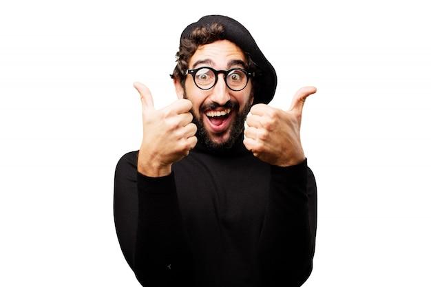 Homem que sorri com dois polegares acima Foto gratuita