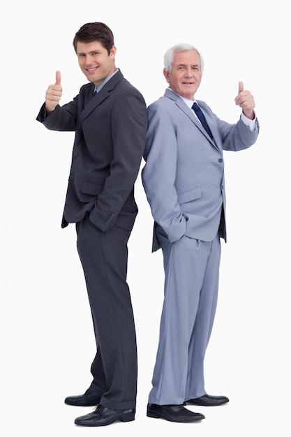 Homens de negócios de pé de costas dando polegares para cima Foto Premium