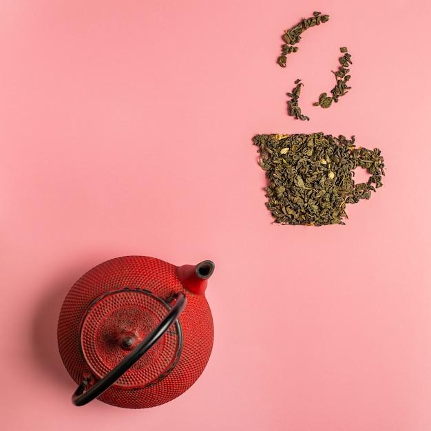 Ícone de xícara de chá feito de folhas secas de chá oolong Foto Premium