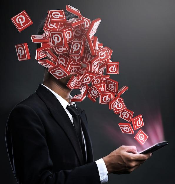 Ícones do pinterest aparecendo na cara de um homem Foto Premium