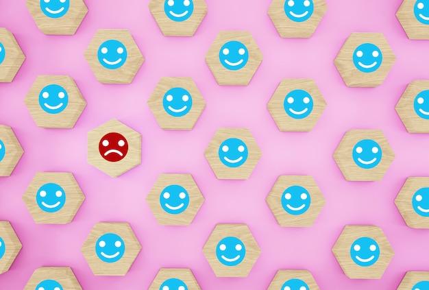 Idéia criativa da pessoa escolhida entre outros. padrão com emoticon de rosto feliz e triste no hexágono de madeira Foto Premium