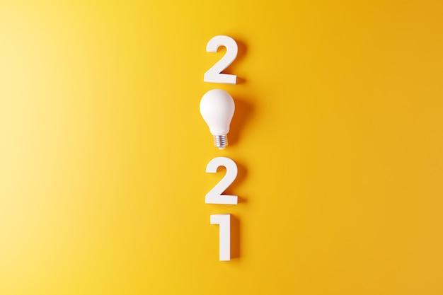 Idéia de lâmpada com fundo amarelo de ano novo 2.021. Foto Premium