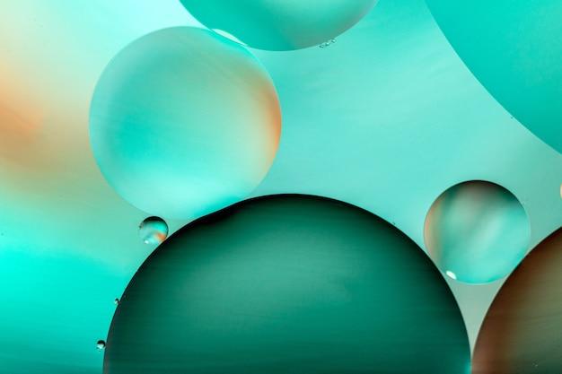 Ilustração gráfica de círculos verdes em fundo verde claro Foto gratuita