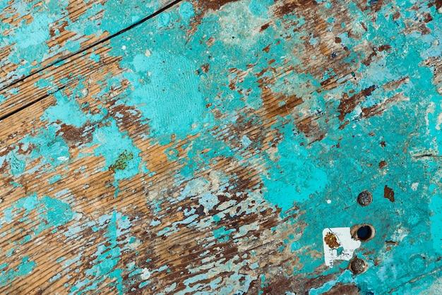 Imagem de fundo da superfície de madeira com pintura descascada Foto Premium