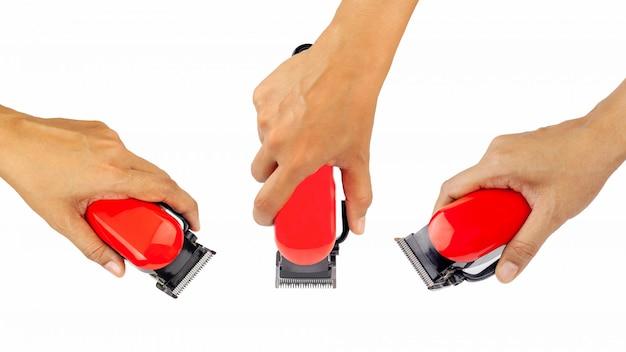 Imagem do close up do braço segurando o hairclipper Foto Premium