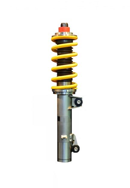 Imagem vertical de um amortecedor amarelo isolado no espaço em branco Foto Premium