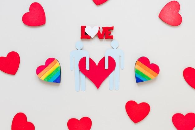 Inscrição de amor com corações de arco-íris e ícone do casal gay Foto gratuita