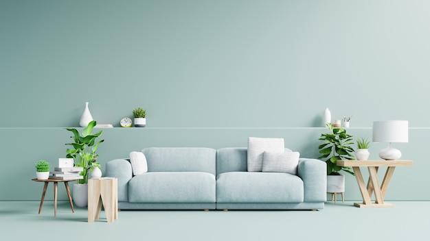 Interior da moderna sala de estar com sofá e plantas verdes, lâmpada, mesa na luz de fundo de parede verde. Foto Premium