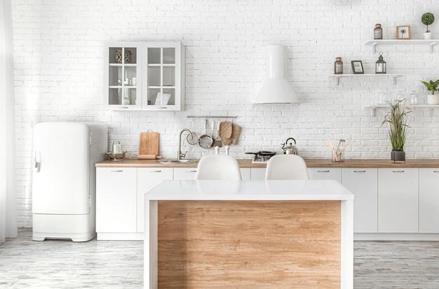 Interior de cozinha escandinavo moderno e elegante com acessórios de cozinha. cozinha branca brilhante com utensílios domésticos. Foto gratuita