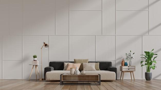 Interior moderno da sala de visitas com sofá e plantas verdes, lâmpada, tabela na parede branca. Foto Premium
