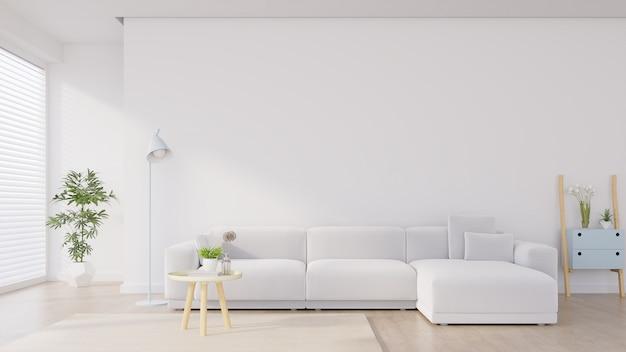 Interior moderno da sala de visitas com sofá e plantas verdes, lâmpada, tabela no fundo branco da parede. Foto Premium