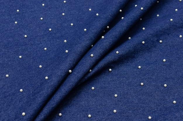 Jeans de tecido de algodão azul com pérolas Foto Premium