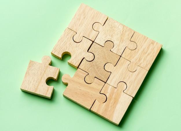 Jigsaw trabalho em equipe conceito tiro macro Foto gratuita