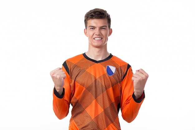 Jogador de futebol comemorando um gol isolado no branco Foto Premium