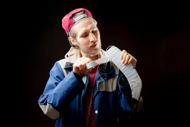 Jogador de hóquei, gravando sua vara close-up Foto Premium