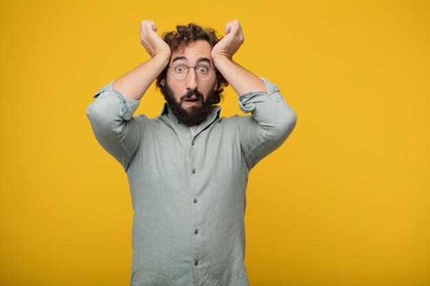 Jovem barbudo empresário expressando um conceito Foto Premium