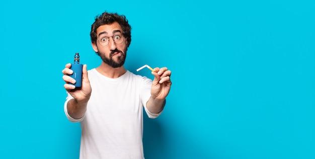 Jovem barbudo fumando com uma erva-cidreira Foto Premium