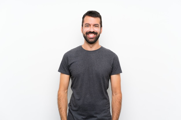 Jovem bonito sobre parede branca isolada sorrindo Foto Premium