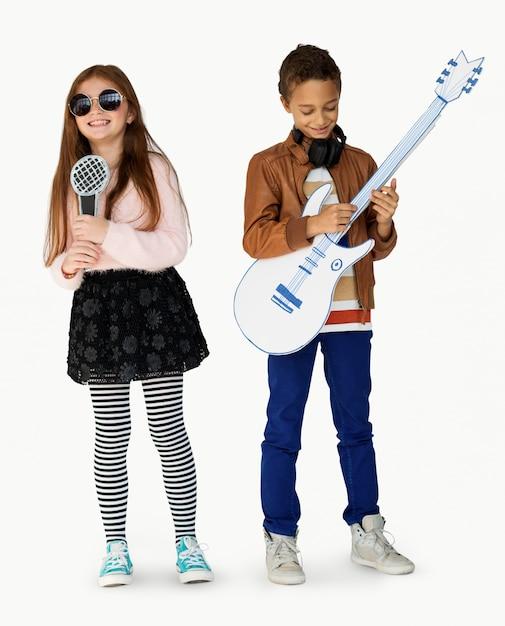 Jovem, crianças, músico, cantor, guitarrista Foto Premium