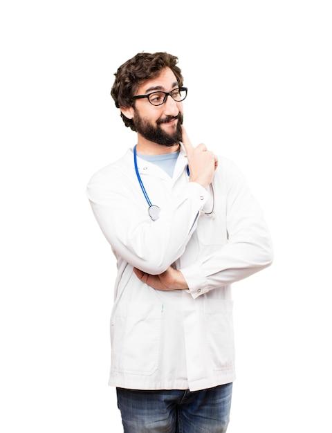 Jovem doutor pensando Foto gratuita