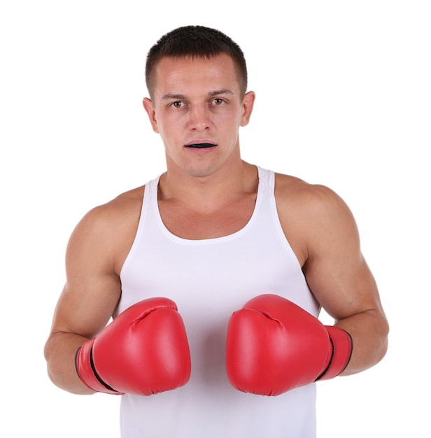 Jovem e bonito desportista musculoso com luvas de boxe em branco Foto Premium