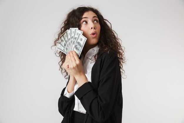 Jovem empresária chocada com dinheiro Foto Premium