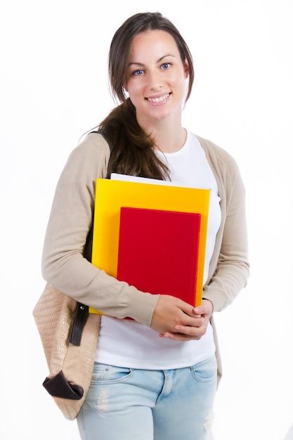 Jovem estudante com seus livros sobre fundo branco Foto gratuita