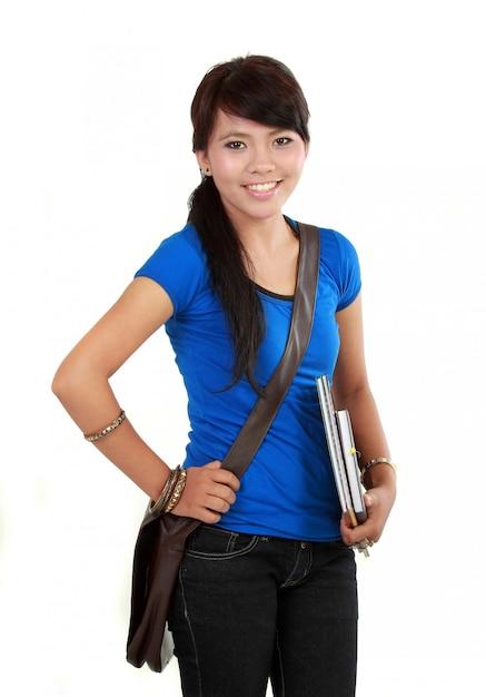 Jovem estudante feliz Foto Premium