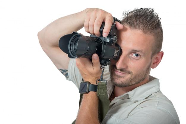 Jovem fotógrafo isolado no branco Foto Premium