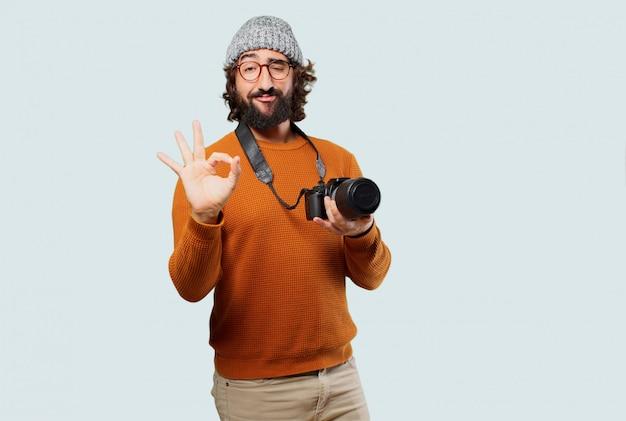 Jovem homem barbudo com câmera fotográfica Foto Premium