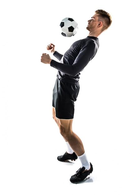 Jovem, loiro, homem, futebol jogando | Foto Premium