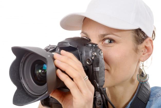 Jovem mulher com uma câmera. estilo de vida jovem Foto Premium