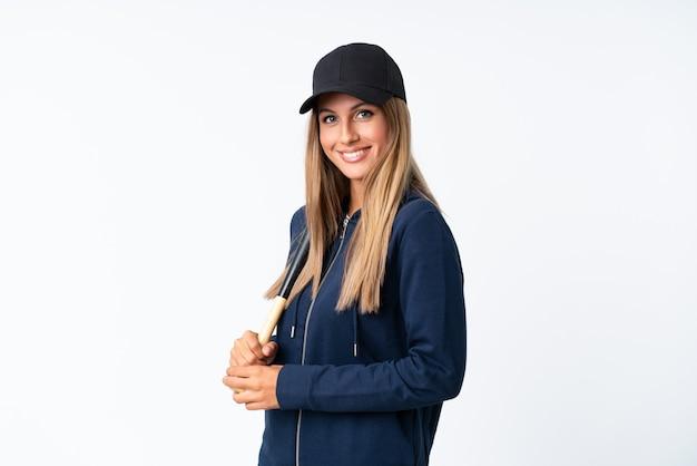 Jovem mulher loira jogando beisebol Foto Premium