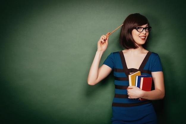 Jovem professor com ponteiro Foto Premium