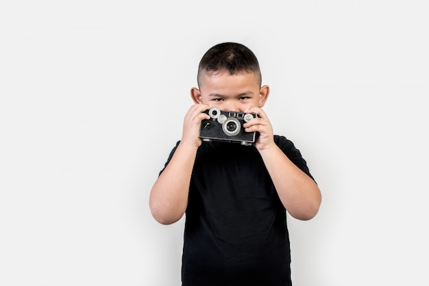 Kid fotógrafo tirar uma foto Foto gratuita