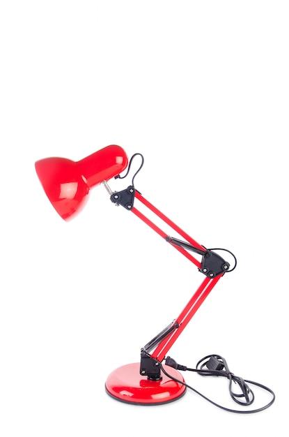 Lâmpada ajustável de mesa vermelha isolada no branco Foto Premium