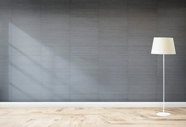 Lâmpada de pé em um quarto cinzento Foto gratuita