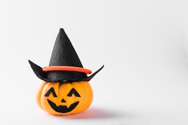 Lanterna de abóbora fantasma sorriso assustador usar chapéu Foto Premium