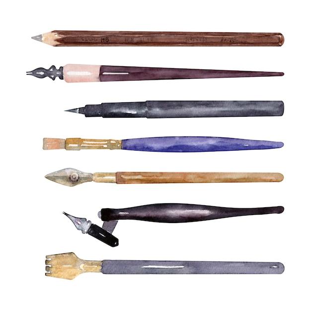 Lápis, pincéis e material para escrever em aquarela Foto Premium