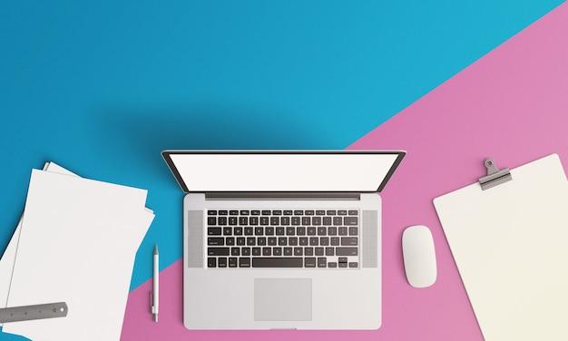 Laptop de maquete criativa e papel no fundo-de-rosa do anúncio azul Foto Premium