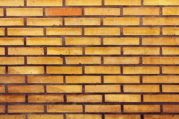 c0b6b5f5e Laranja textura da parede de tijolo Foto gratuita