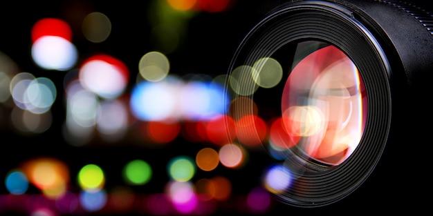 Lentes fotográficas e luzes da rua da cidade bokeh Foto Premium