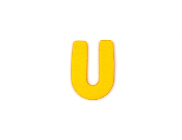 Letra amarela u Foto gratuita